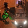 Egyptian riot police beat a man, illuminated by the green light of a protester\'s laser, after stripping him, and before dragging him into a police van, during clashes next to the presidential palace in Cairo, Friday, Feb. 1, 2013. Protesters denouncing Egypt\'s Islamist president hurled stones and firebombs through the gates of his palace gates on Friday, clashing with security forces who fired tear gas and water cannons, as more than a week of political violence came to Mohammed Morsi\'s symbolic doorstep for the first time. (AP Photo/Khalil Hamra)