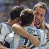 Photo - Argentina's Gonzalo Higuain, right, embraces Lionel Messi after he scored the opening goal against Belgium during the World Cup quarterfinal soccer match between Argentina and Belgium at the Estadio Nacional in Brasilia, Brazil, Saturday, July 5, 2014. (AP Photo/Martin Meissner)