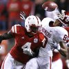 Nebraska\'s Larry Asante (4) breaks up a pass for Oklahoma\'s Adron Tennell (80) during the first half of the college football game between the University of Oklahoma Sooners (OU) and the University of Nebraska Cornhuskers (NU) on Saturday, Nov. 7, 2009, in Lincoln, Neb. Photo by Chris Landsberger, The Oklahoman