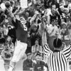 OU COLLEGE FOOTBALL: 11/24/73. Happiness for Sooners is the outstretched arms of an official and quarterback Steve Davis after one of his three touchdowns against Nebraska. Staff photo by Hank Mooney.