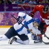 Photo - Finland forward Jori Lehtera fights Canada forward John Tavares for the puck in the third period of a men's ice hockey game at the 2014 Winter Olympics, Sunday, Feb. 16, 2014, in Sochi, Russia. (AP Photo/Mark Humphrey)