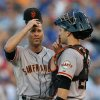 Photo - San Francisco Giants catcher Buster Posey, right,  talks with starting pitcher Tim Hudson in the fifth inning during a baseball game against the Kansas City Royals, Saturday, Aug. 9, 2014, in Kansas City, Mo. (AP Photo/Ed Zurga)