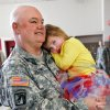 Chief Warrant Officer 3 Danny Collins of Purcell holds one of his seven grandchildren after the 45th Infantry Brigade Combat Team Deployment Ceremony in downtown Oklahoma City, Wednesday, Feb. 16, 2011. Paige Collins, 3, of Davis, OK, lays her head against her grandfather\'s uniform. The girl\'s father was serving in Iraq when she was born. Four months after he returned home from duty, he was killed in a motorcycle crash. This will be Collins\' third deployment in the last 20 years. Collins said that at one point, he and three sons were serving in the military. One of his sons is deploying with the Guard group today. Photo by Jim Beckel, The Oklahoman