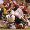 Oklahoma\'s Tom Wort (21) puts a hit on Missouri\'s T.J. Moe (28) during the college football game between the University of Oklahoma Sooners (OU) and the University of Missouri Tigers (MU) at the Gaylord Family-Memorial Stadium on Saturday, Sept. 24, 2011, in Norman, Okla. Photo by Chris Landsberger, The Oklahoman