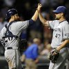 Photo - Milwaukee Brewers' Jonathan Lucroy (20) and Rob Wooten (47) celebrate their 5-0 victory over the Chicago Cubs after a baseball game, Monday, July 29, 2013, in Chicago. (AP Photo/Jim Prisching)