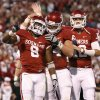 Oklahoma\'s Dominique Whaley (8), Gabe Ikard (64), and Landry Jones (12) celebrate after a touchdown during the college football game between the University of Oklahoma Sooners (OU) and the Ball State Cardinals at Gaylord Family-Memorial Stadium on Saturday, Oct. 01, 2011, in Norman, Okla. Photo by Bryan Terry, The Oklahoman