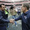 Photo - Houston Texans coach Gary Kubiak, left, and New England Patriots coach Bill Belichick, right, shake hands following an NFL football game on Sunday, Dec. 1, 2013, in Houston. (AP Photo/David J. Phillip)