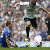Photo - Tottenham Hotspur's Gylfi Sigurdsson, right, jumps over a tackle from Chelsea's John Terry and go on to score during their English Premier League soccer match at White Hart Lane, London, Saturday, Sept. 28, 2013. (AP Photo/Sang Tan)