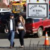 Parents walk away from the Sandy Hook Elementary School with their children following a shooting at the school, Friday, Dec. 14, 2012 in Newtown, Conn. A man opened fire inside the Connecticut elementary school where his mother worked Friday, killing 26 people, including 20 children, and forcing students to cower in classrooms and then flee with the help of teachers and police. (AP Photo/The Journal News, Frank Becerra Jr.) MANDATORY CREDIT, NYC OUT, NO SALES, TV OUT, NEWSDAY OUT; MAGS OUT ORG XMIT: NYWHI120
