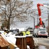 Utility workers the the power lines as snow covered debris from Superstorm Sandy lay on the side of a street following a nor\'easter storm, Thursday, Nov. 8, 2012, in Point Pleasant, N.J. The New York-New Jersey region woke up to wet snow and more power outages Thursday after the nor\'easter pushed back efforts to recover from Superstorm Sandy, that left millions powerless and dozens dead last week. (AP Photo/Julio Cortez)
