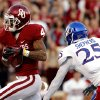 Oklahoma Sooners\'s Kenny Stills (4) tucks a pass and scores trailed by Brandon Bourbon during the college football game between the University of Oklahoma Sooners (OU) and the University of Kansas Jayhawks (KU) at Gaylord Family-Oklahoma Memorial Stadium in Norman, Okla., on Saturday, Oct. 20, 2012. Photo by Steve Sisney, The Oklahoman