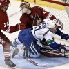Vancouver Canucks\' Daniel Sedin (22), of Sweden, collides with Phoenix Coyotes\' Mike Smith as Coyotes\' Michael Stone (29) watches during the second period in an NHL hockey game, Thursday, March 21, 2013, in Glendale, Ariz. (AP Photo/Ross D. Franklin)