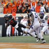 Oklahoma State\'s Charlie Moore (17) dives for touchdown in front of TCU\'s Kenny Cain (51) and Joel Hasley (36) during a college football game between Oklahoma State University (OSU) and Texas Christian University (TCU) at Boone Pickens Stadium in Stillwater, Okla., Saturday, Oct. 27, 2012. Photo by Sarah Phipps, The Oklahoman