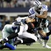 Philadelphia Eagles tight end Brent Celek (87) is brought down by Dallas Cowboys cornerback Brandon Carr (39) and inside linebacker Ernie Sims during the first half of an NFL football game, Sunday, Dec. 2, 2012, in Arlington, Texas. (AP Photo/LM Otero)