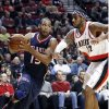 Atlanta Hawks forward Al Horford, left, drives the baseline on Portland Trail Blazers forward LaMarcus Aldridge during the first half of their NBA basketball game in Portland, Ore., Monday, Nov. 12, 2012. (AP Photo/Don Ryan)