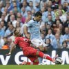 Photo -   Manchester City's Sergio Aguero, centre, is tackled before falling injured by Southampton's Nathaniel Clyne during their English Premier League soccer match at The Etihad Stadium, Manchester, England, Sunday, Aug. 19, 2012. (AP Photo/Jon Super)