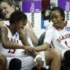 Danielle Robinson (13) and Nyeshia Stevenson (1) celebrate as the University of Oklahoma (OU) defeats Georgia Tech 69-50 in round two of the 2009 NCAA Division I Women\'s Basketball Tournament at Carver-Hawkeye Arena at the University of Iowa in Iowa City, IA on Tuesday, March 24, 2009. PHOTO BY STEVE SISNEY, THE OKLAHOMA