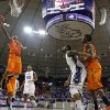 Oklahoma State guard Marcus Smart (33) goes up for a basket after getting by TCU \'s Devonta Abron (23) in the first half of an NCAA basketball game on Wednesday, Feb. 27, 2013, in Fort Worth, Texas. (AP Photo/Tony Gutierrez) ORG XMIT: TXTG102