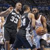 Oklahoma City\'s James Harden (13) collides with San Antonio\'s Gary Neal (14) as San Antonio\'s Boris Diaw looks on during Game 6 of the Western Conference Finals between the Oklahoma City Thunder and the San Antonio Spurs in the NBA playoffs at the Chesapeake Energy Arena in Oklahoma City, Wednesday, June 6, 2012. Photo by Chris Landsberger, The Oklahoman