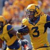 West Virginia running back Charles Sims (3) rushes for 25 yards in the third quarter of an NCAA college football game against Oklahoma State in Morgantown, W.Va., on Saturday, Sept. 28, 2013. (AP Photo/Tyler Evert) ORG XMIT: WVTE110