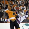 Philadelphia Flyers\' Tye McGinn, left, and New York Rangers\' Ryan Callahan collide during the first period of an NHL hockey game, Thursday, Jan. 24, 2013, in Philadelphia. (AP Photo/Matt Slocum)