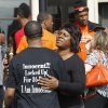 Photo - Mildred Williams, right, an aunt to Darrell Williams, embraces a supporter outside the courthouse in Stillwater, Okla., Friday, Oct. 12, 2012, following a sentencing hearing. Supporters had packed the courtroom for Williams' sentencing, some wearing black T-shirts that said
