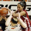 Oklahoma\'s Nicole Griffin (4), top, collides with Oklahoma State\'s Liz Donohoe (4) during the Bedlam women\'s college basketball game between Oklahoma State University and the University of Oklahoma at Gallagher-Iba Arena in Stillwater, Okla., Saturday, Feb. 23, 2013. OSU beat OU, 83-62. Photo by Nate Billings, The Oklahoman