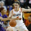 Oklahoma State\'s Liz Donohoe (4) defends TCU\'s Natalie Ventress (24) during a women\'s college basketball game between Oklahoma State University and TCU at Gallagher-Iba Arena in Stillwater, Okla., Tuesday, Feb. 5, 2013. Photo by Bryan Terry, The Oklahoman