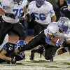 Guthrie\'s Kai Callins is brought down by Deer Creek\'s Kyle Sander during their high school football game at Deer Creek in Oklahoma City, Friday, October 25, 2013. Photo by Bryan Terry, The Oklahoman
