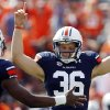 Photo -   Auburn kicker Cody Parkey (36) celebrates with holder Ryan White after kicking the winning field goal to defeat Louisiana-Monroe 31-28 in overtime of an NCAA college football game, Saturday, Sept. 15, 2012, in Auburn, Ala. (AP Photo/Butch Dill)