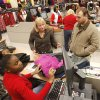 Cashier Precious Turner rings up the purchases for customers Adam and Christy Tester during early morning Black Friday shopping at the Kohl\'s store in Midwest City, OK, Friday, November 23, 2012, By Paul Hellstern, The Oklahoman