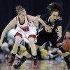 Purdue guard KK Houser, right, battles for a loose ball with Nebraska guard Lindsey Moore during the first half of an NCAA college basketball game in the Big Ten Conference tournament in Hoffman Estates, Ill., on Saturday, March 9, 2013. (AP Photo/Nam Y. Huh)