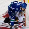 Vancouver Canucks\' Zack Kassian, top, falls on Chicago Blackhawks goalie Corey Crawford during the second period of an NHL hockey game in Vancouver, British Columbia, on Friday, Feb. 1, 2013. (AP Photo/The Canadian Press, Darryl Dyck)
