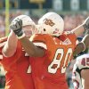 (Stillwater, Saturday,10/18/2003: OKLAHOMA STATE UNIVERSITY COLLEGE FOOTBALL: OSU VS TEXAS TECH Boone Pickens Stadium) OSU\'s Doug Koenig celebrates with Charlie Johnson after Johnson scored on a short pass in the first half. (Staff photo by Steve Gooch)