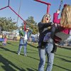 Stacy Redwine swings daughter LeAnna, 3, as the family enjoys the warm weather at a playground at First Baptist Church on Wednesday, Dec. 28, 2011, in Norman, Okla. Redwine, from Marietta, is visiting family in Norman over the holidays. Photo by Steve Sisney, The Oklahoman