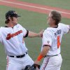 Photo - Oregon State's Ben Wetzler (9) and Andy Peterson (1) prepare to lock arms in celebration of Peterson scoring a run against UC Irvine during an NCAA college baseball regional tournament game in Corvallis, Ore., Sunday, June 1, 2014. (AP Photo/Mark Ylen)