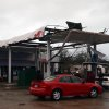 Hattiesburg Police officers talk to onlookers at a damaged gas station in Hattiesburg, Miss. after an apparent tornado that moved through area on Sunday, Feb. 10, 2013. (AP Photo/The Hattiesburg American, Bryant Hawkins)