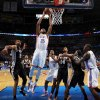 Oklahoma City\'s Kevin Durant (35) dunks the ball next to, from left, San Antonio\'s Tim Duncan (21), San Antonio\'s Tony Parker (9), Oklahoma City\'s Serge Ibaka (9), San Antonio\'s Gary Neal (14), San Antonio\'s Kawhi Leonard (2) and Oklahoma City\'s Kendrick Perkins (5) during an NBA basketball game between the Oklahoma City Thunder and the San Antonio Spurs at Chesapeake Energy Arena in Oklahoma City, Thursday, April 4, 2013. Photo by Nate Billings, The Oklahoman