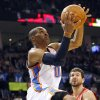 Oklahoma City\'s Russell Westbrook puts up a shot in front of Houston\'s defense during their NBA basketball game at the OKC Arena in downtown Oklahoma City on Wednesday, Nov. 17, 2010. Photo by John Clanton, The Oklahoman