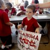 Kadin Smith, 4, of Lawton walks away after getting an autograph during the University of OKlahoma\'s Meet the Sooners Day at Gaylord Family-Oklahoma Memorial Stadium in Norman, Okla., Saturday, August 6, 2011. Photo by Bryan Terry, The Oklahoman