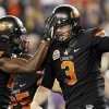 Oklahoma State\'s Brandon Weeden (3) celebrates his touchdown against Stanford with teammate Justin Blackmon during the first half of the Fiesta Bowl NCAA college football game Monday, Jan. 2, 2012, in Glendale, Ariz.(AP Photo/Ross D. Franklin)