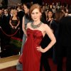 ** LINDA MILLER\'S COMMENTARY: Wear red if you want to get noticed. Love, love, love that necklace. I\'m so buying oversize jewelry this spring. ** Actress Amy Adams, nominated for an Oscar for Best Actress in a Supporting Role for her work in