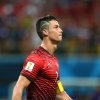 Photo - Portugal's Cristiano Ronaldo walks on the pitch during the group G World Cup soccer match between the USA and Portugal at the Arena da Amazonia in Manaus, Brazil, Sunday, June 22, 2014. (AP Photo/Paulo Duarte)