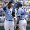 Photo - Kansas City Royals starting pitcher Yordano Ventura, left, talks with catcher Salvador Perez during the first inning of a baseball game against the Minnesota Twins, Sunday, April 20, 2014, at Kauffman Stadium in Kansas City, Mo. (AP Photo/Charlie Riedel)