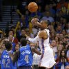 Oklahoma City\'s Russell Westbrook (0) passes the ball over Dallas\' Elton Brand (42) and Darren Collison (4) during an NBA basketball game between the Oklahoma City Thunder and the Dallas Mavericks at Chesapeake Energy Arena in Oklahoma City, Thursday, Dec. 27, 2012. Oklahoma City won 111-105. Photo by Bryan Terry, The Oklahoman