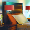 Wall-mounted fixtures with swing arms on either side of the bed let you shine light where you want it, and also leave more room on nightstands. Photo provided