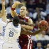 Oklahoma\'s Taylor Griffin (32) defends on North Carolina\'s Ty Lawson (5) during the second half in the Elite Eight game of NCAA Men\'s Basketball Regional between the University of North Carolina and the University of Oklahoma at the FedEx Forum on Sunday, March 29, 2009, in Memphis, Tenn. PHOTO BY CHRIS LANDSBERGER, THE OKLAHOMAN