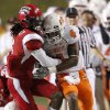 OSU\'s Justin Gilbert fights off Louisiana-Lafayette\'s Dwight Bentley on a return during the football game between the University of Louisiana-Lafayette and Oklahoma State University at Cajun Field in Lafayette, La., Friday, October 8, 2010. Photo by Bryan Terry, The Oklahoman