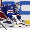 Photo - New York Rangers goalie Henrik Lundqvist (30) of Sweden makes a save in the second period of their NHL hockey game against the Washington Capitals at Madison Square Garden in New York, Sunday, Jan. 19, 2014. (AP Photo/Kathy Willens)