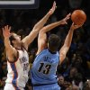 Nenad Krstic (12) of Oklahoma City tries to block the shot of Mehmet Okur (13) of Utah during the NBA basketball game between the Oklahoma City Thunder and the Utah Jazz at the Ford Center in Oklahoma City, Thursday, December 31, 2009. Photo by Nate Billings, The Oklahoman